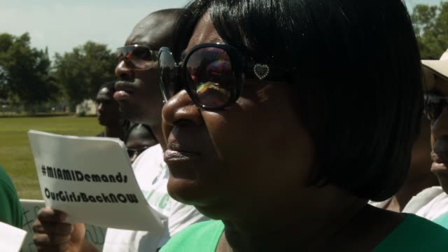 cu people gather to support the coalition of concerned nigerians in south florida during a rally to show support for national and international... - florida south africa stock videos & royalty-free footage