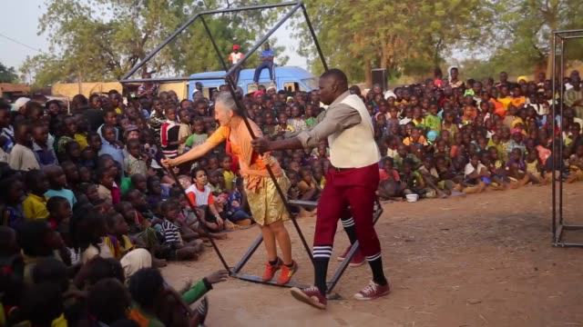 People gather to watch show of performer from France and motorcycle aerobatics as a part of local festival in Ouagadougou Burkina Faso on February 10...