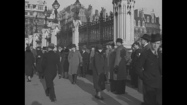 vs people gathered around the wrought iron fence at parliament / three men wearing newsboy caps / vs prime minister stanley baldwin exits 10 downing... - abdication stock videos and b-roll footage