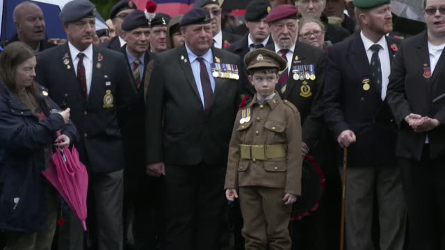 people gathered at accrington cenotaph on the armistice day centenary - remembrance sunday stock videos & royalty-free footage