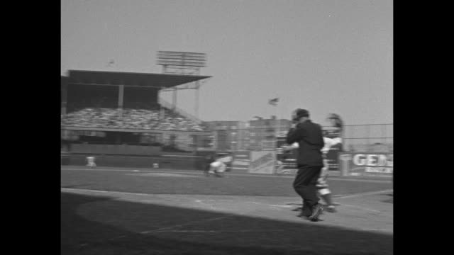 vs people gathered at entrance to ebbets field òbeeró sign at right people in line at the $1 window / packed stadium / brooklyn dodgers take to field... - straw hat stock videos and b-roll footage