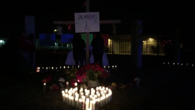 People gathered at the San Manuel Stadium for a candlelight vigil in San Bernardino Calif Additional various clips of memorial just about a block...
