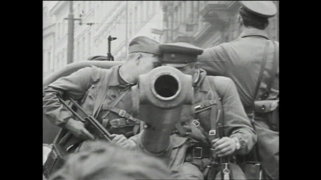 people gathered at wenceslas square during the soviet invasion of czechoslovakia; russian military official talking with someone in the crowd; close... - prague old town square stock videos & royalty-free footage