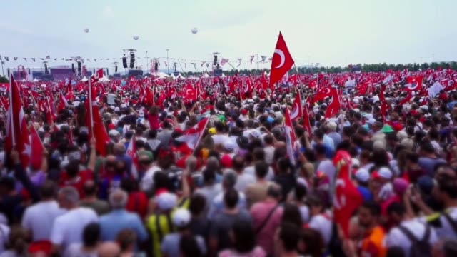 people gathered in a square for the rally and they are holding the turkish flag in their hands. - islam stock videos & royalty-free footage