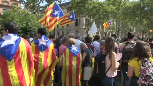 People gathered in Barcelona for a second day of protests on Thursday as Catalonia's vicepresident admitted that plans to hold an outlawed...