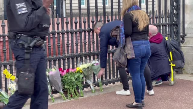 people gathered in front of the buckingham palace to laid flowers for commemoration prince philip. britain's prince philip has died at the age of 99... - carefree stock videos & royalty-free footage