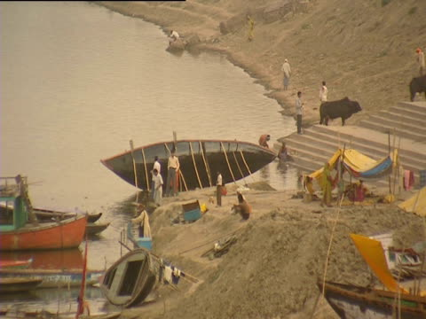 people gathered on banks of river ganges - number of people stock videos & royalty-free footage