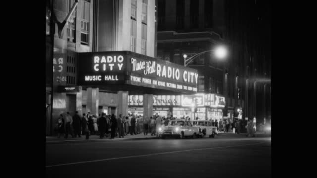 people gathered outside radio city music hall, rockefeller center, midtown manhattan, new york city, new york state, usa - radio city music hall stock videos & royalty-free footage