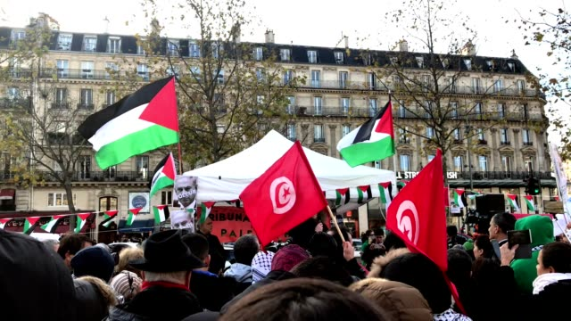 People gathered to protest against Israel at Place de la République in Paris France Palestinian flags crowd and messages against Israel