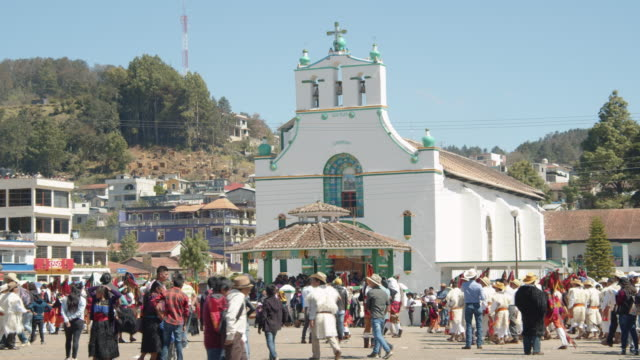 people gathering in front of the church of san juan chamula during the traditional syncretic town festival - minority groups stock videos & royalty-free footage