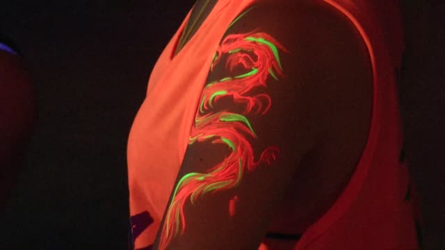 people get body painted during the full moon party on the beach on ko phangan in thailand on jan 4 2015 - ko phangan stock videos and b-roll footage