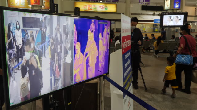 people get their temperature tested before departing bangkok from mochit bus station in large numbers after the bangkok government ordered shutdown... - thermal imaging stock videos & royalty-free footage