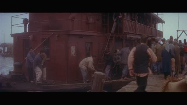 stockvideo's en b-roll-footage met ms people getting in ferryboat / hong kong  - breedbeeldformaat