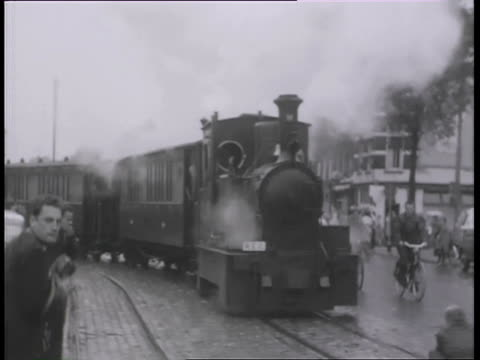 ms  people getting in off and  waiting for  train which is designed to climb very steep hills / brienz, interlaken oberhasil, switzerland - locomotive video stock e b–roll