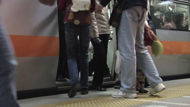 ms people getting off and on the number 13 subway train before the doors close/ beijing, china - getting out stock videos & royalty-free footage