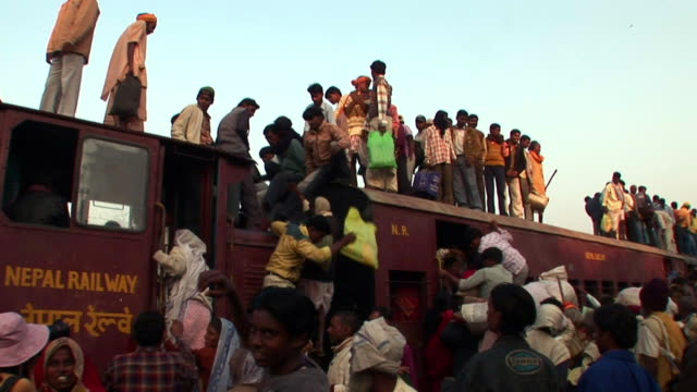 people getting off from roof of train - dhoti video stock e b–roll