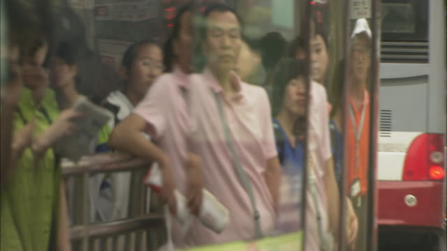 ms people getting on bus at bus stop, beijing, china - guy waving stock videos & royalty-free footage