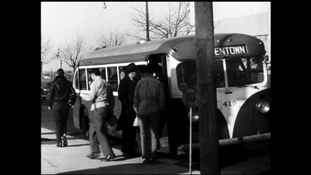 "vídeos y material grabado en eventos de stock de people getting on bus parked by the sidewalk; bus stops at the sidewalk and people getting off, sign on the bus ""allentown"" - 1940 1949"
