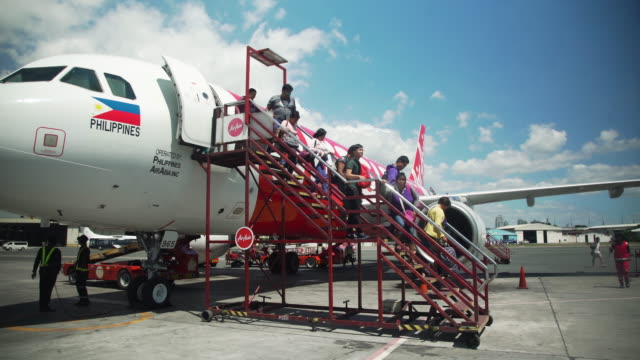 people getting out from airplane at manila airport - philippines flag stock videos & royalty-free footage