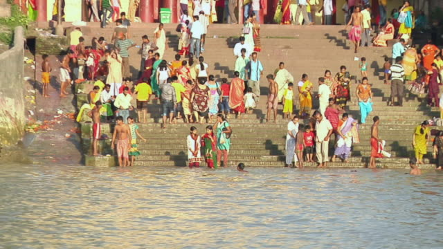 ms zo people getting out from dakshineshwar temple and getting steps down in hooghly river for prayer / kolkata, west bengal, india - hooghly river stock videos & royalty-free footage