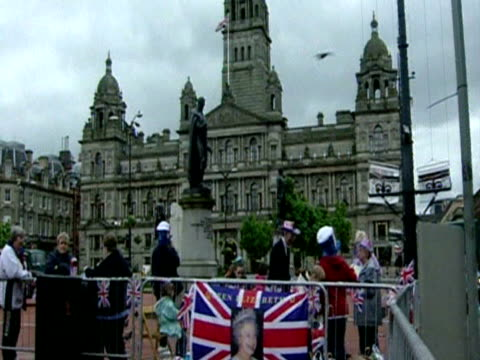 people getting ready for the queen's visit as part of her golden jubilee royal tour george square glasgow - golden jubilee stock videos & royalty-free footage