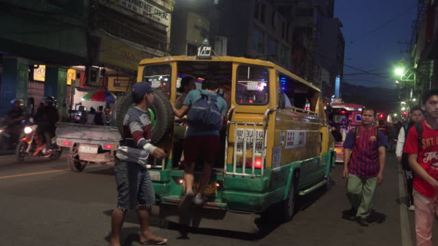 People getting to Jeepney transportation at Cebu city Colon street at night b-roll, Philippines