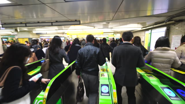 people go through the automatic ticket gates at jr shinjuku station. - busy morning stock videos & royalty-free footage