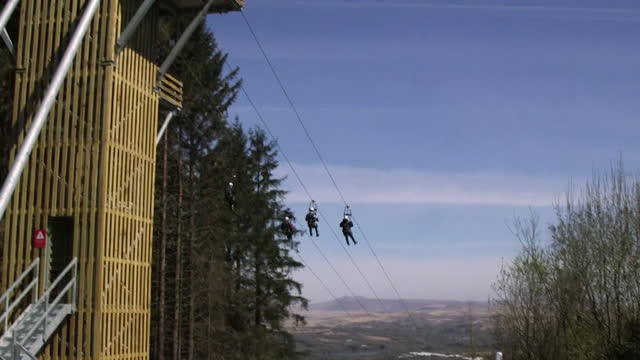 people going down zipwire at zipworld tower in aberdare, wales - extreme sports stock videos & royalty-free footage