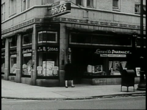 1946 - people going in and out of corner drugstore - prelinger archive stock videos & royalty-free footage