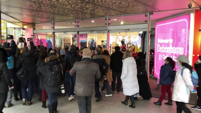 people going into debenhams on oxford street, to take advantage of their closing down sale, as the company goes into administration and coronavirus... - clothes shop stock videos & royalty-free footage