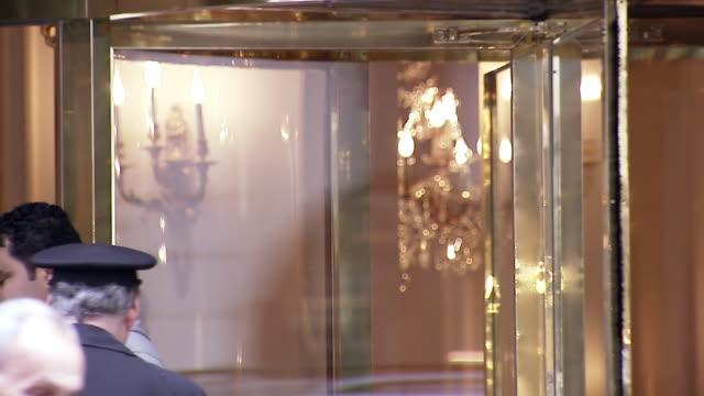 vidéos et rushes de ms people going through revolving door at entrance of hotel le bristol / paris, france - palace