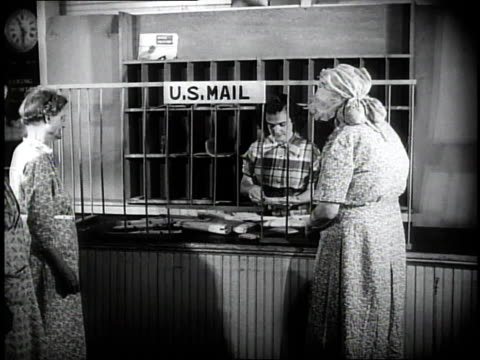 1950 montage people going to the window at the post office / southville, kentucky, united states - postamt stock-videos und b-roll-filmmaterial