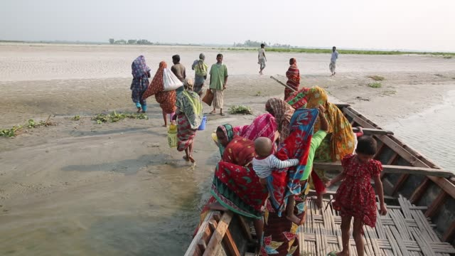 people going to work in the cropland on the dried-up river tista during summer in bangladesh. they have lost their houses and land during flood in... - climate stock videos & royalty-free footage