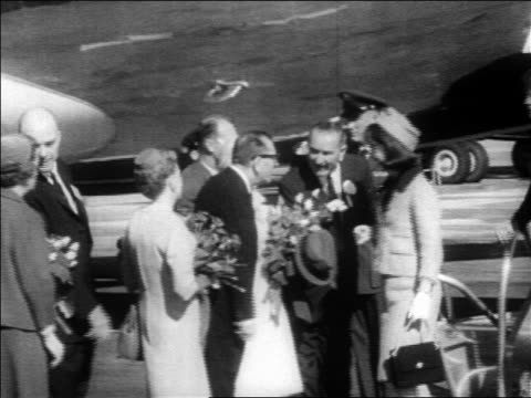 stockvideo's en b-roll-footage met b/w 1963 people greeting john jacqueline kennedy at dallas airport / newsreel - jacqueline kennedy