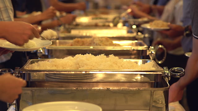 people group catering buffet food indoor in the restaurant. - buffet stock videos & royalty-free footage