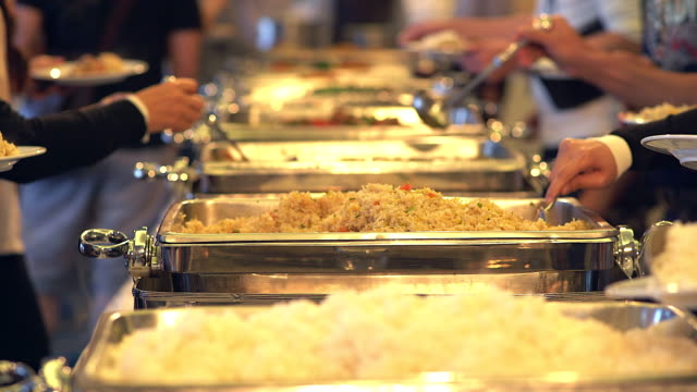 People group catering buffet food indoor in the restaurant.