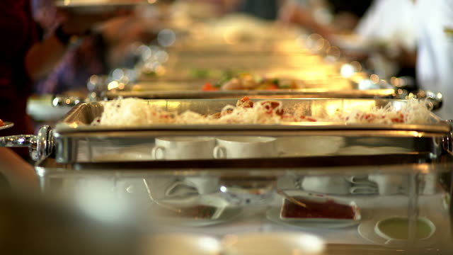 vídeos de stock e filmes b-roll de people group catering buffet food indoor in the restaurant. - part of a series