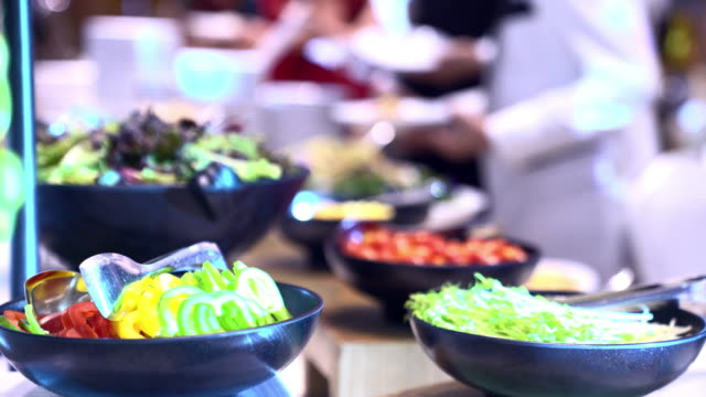 people hand catering buffet food. - food bar stock videos and b-roll footage