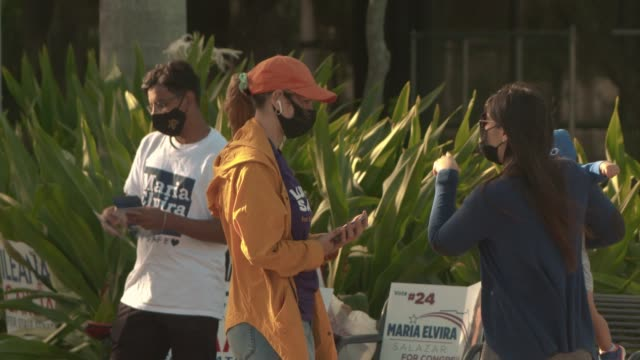 people hand out pamphlets in miami-dade county on election day on november 3, 2020 in miami, florida. voters are going to the polls to vote for... - miami dade county stock videos & royalty-free footage