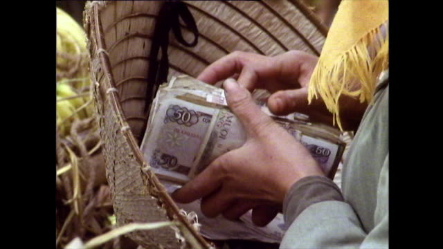 people handling cash with hands and feet in market; 1989 - banknote stock videos & royalty-free footage