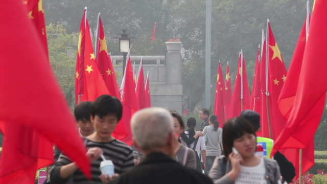 ls people hang national flags outdoor during the china national day/xian,shaanxi,china - chinese flag stock videos and b-roll footage