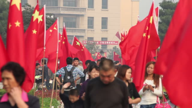 ls people hang national flags outdoor during the china national day/xian,shaanxi,china - chinese flag stock videos & royalty-free footage