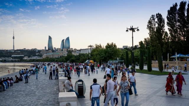 tl people have a rest on the waterfront, dusk / azerbaijan, baku - azerbaigian video stock e b–roll