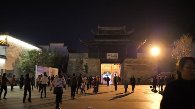 people have square dance at the famous huizhou ancient city which located in the foot of famous mount huangshan on nov 26 2017 in china - storia sociale video stock e b–roll
