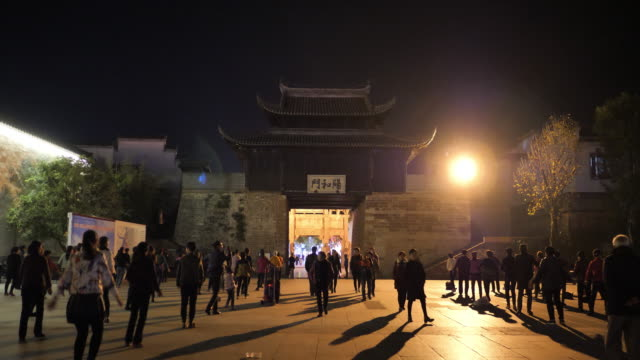people have square dance at the famous huizhou ancient city which located in the foot of famous mount huangshan on nov 26 2017 in china - gesellschaftsgeschichte stock-videos und b-roll-filmmaterial