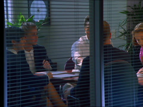 vídeos de stock, filmes e b-roll de people having business meeting in conference room - 2001