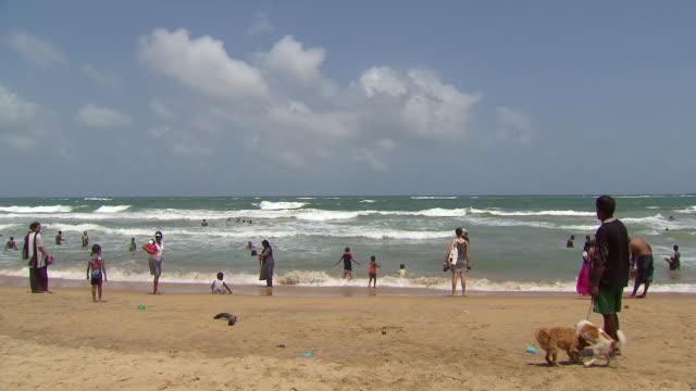 ws people having fun and swimming at beach / negombo, sri lanka - sri lanka people stock videos & royalty-free footage