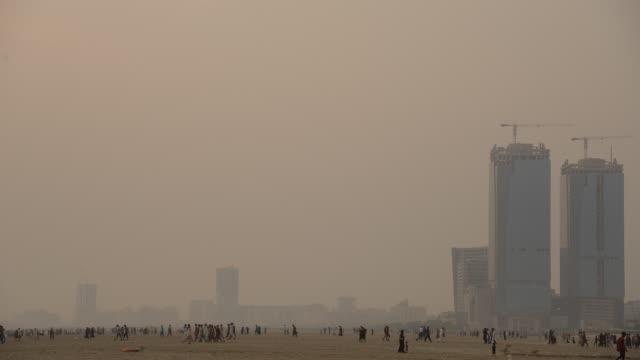 people having fun at beach - timelapse - karachi stock videos & royalty-free footage