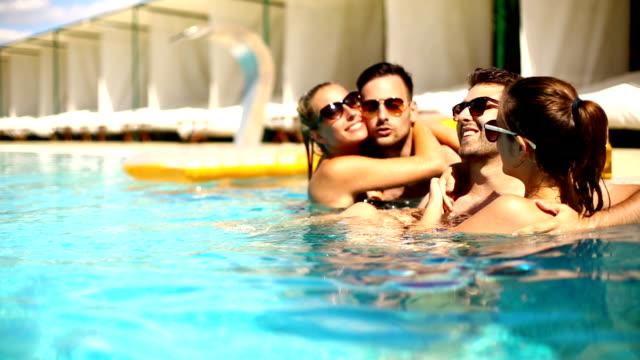 people having fun at swimming pool. - sunbathing stock videos & royalty-free footage