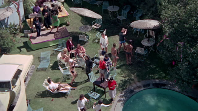people having fun. go-go dancing at pool party in the 1960s. - youth culture stock videos & royalty-free footage